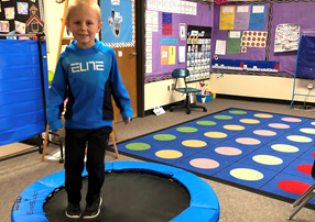 Student on fitness trampoline in classroom